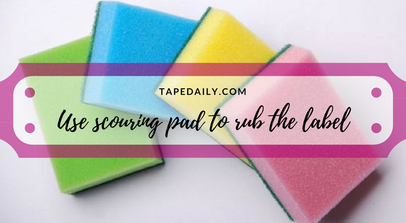use scouring pad to rub the label