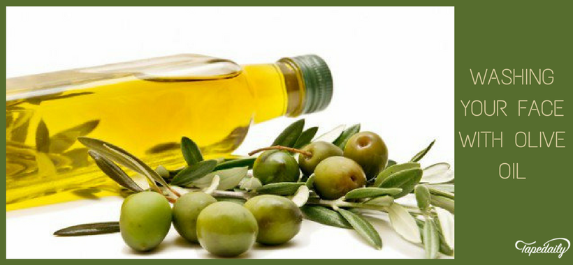 Washing face with olive oil