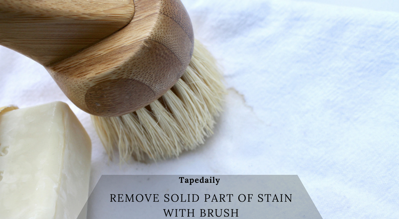 remove solid part of stain with brush