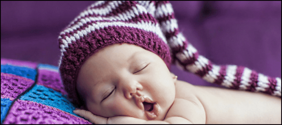 Sleeping baby with open mouth